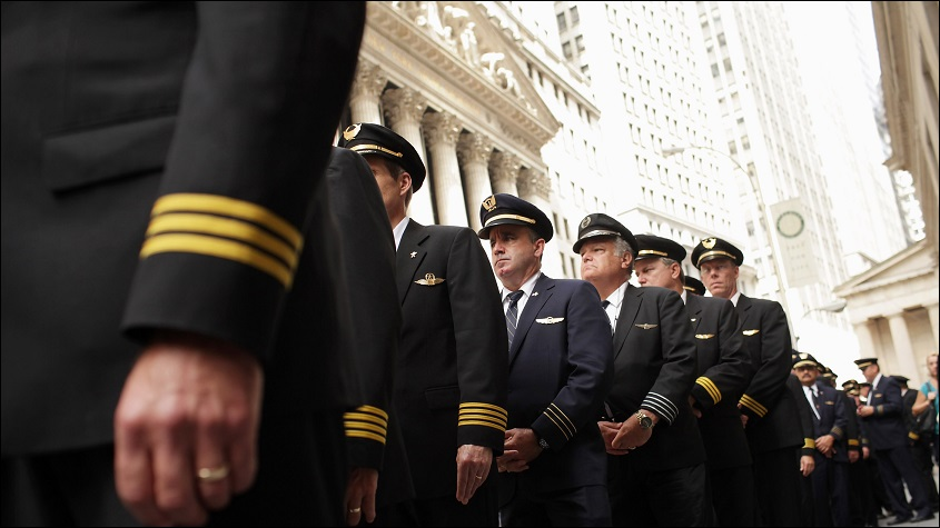 NEW YORK, NY - SEPTEMBER 27: Over 700 hundred Continental and United pilots, joined by additional pilots from other Air Line Pilots Association (ALPA) carriers, demonstrate in front of Wall Street on September 27, 2011 in New York City. The pilots want to draw attention to the lack of progress on negotiations of the pilots' joint collective bargaining agreement ahead of the one-year anniversary of the corporate merger close date of United and Continental airlines. (Photo by Spencer Platt/Getty Images)